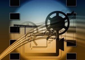 Silhouette de caméra et bobines de film
